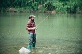 Male Fishing On The Lake. Relax In Natural Environment. Good Profit. Carry On Fishing. Man Relaxing  poster