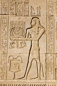 picture of life after death  - Ancient Egyptian bas relief carving of a priest making an offering to the god Ka.  Ka is a complex yet vital figure in the belief of life after death.  Outer wall of Dendera Temple near Qena, Egypt.