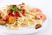 serving of pasta linguine with delicious marinara sauce and seafood