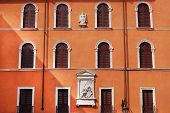 picture of alighieri  - elegant face in historic Verona with wooden shutters - JPG