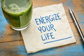 energize your life - inspirational handwriting on a napkin with a glass of green juice, healthy eati poster