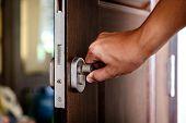 Hand Locking The Wooden Door poster