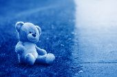 Cute Adorable Lost Abandoned Stuffed Children Toy Teddy Bear Left On Ground Street Road. Lost Lonely poster