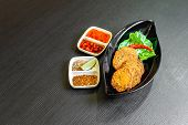 Spicy Fried Fish Cake, (tod Mun Pla), A Traditional Thailand Appetizer Is Made With Fresh Fish Paste poster