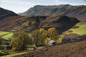 Old Abandoned Farm Buildings In Autumn Fall Landscape Image In Lake District With Sleet Fell In Back poster