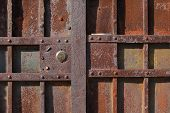 Closeup Of Old Rusty Metal Lock And Keyhole On A Old Iron Door As A Beautiful Vintage Background. Fr poster