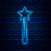 Glowing Neon Line Magic Wand Icon Isolated On Brick Wall Background. Star Shape Magic Accessory. Mag poster