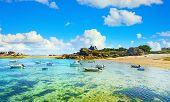 Tregastel, Boats In Beach Bay. Pink Granite Coast And Atlantic Ocean. Armor Coast, Brittany, France. poster