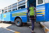 Young Backpack Traveler Getting Into Old Bus. Local Bus In Kanchanaburi Province In Western Of Thail poster
