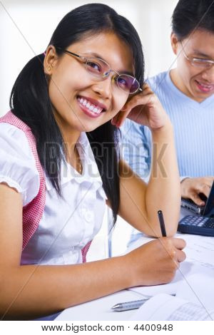 Female Scholar Smiling To Camera