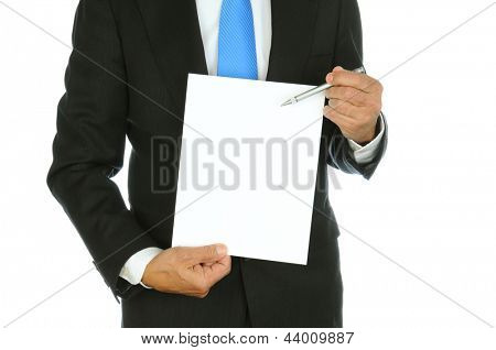 Closeup of a businessman using his pen to point at the blank sheet of paper he is holding. Man is unrecognizable, torso only, over a white background.