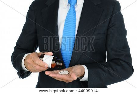 Closeup of a Businessman pouring pills from a prescription bottle into his hand.Torso and hands only, man is unrecognizable. Horizontal format over a white background.