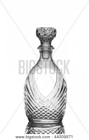 Closeup of a cut crystal whiskey decanter isolated on white with reflection.