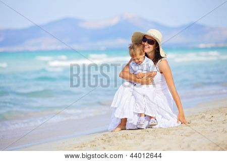 mother and son having fun beach