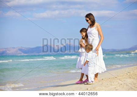 Mother with kids on beach