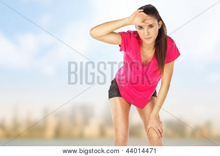 Young Woman Tired After Sport In Outdoors