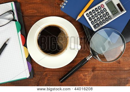 Cup of coffee on worktable close up