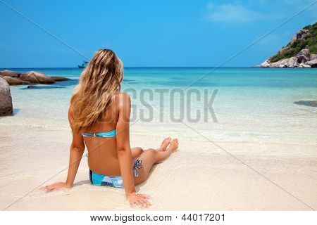 Woman Relaxing On Beach