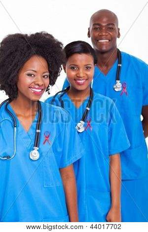 group of african medical workers with red ribbon for HIV awareness