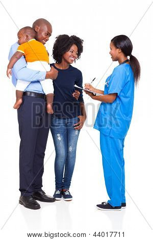 young female nurse chatting with african family isolated on white background