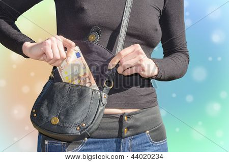Sexy Woman Puts A Bundle Of Cash In Your Purse On Colorful Blured Background