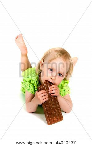 Young Girl Eating Bar Of Chocolate