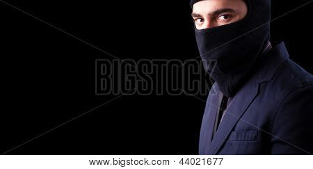 Disguise thief against black background