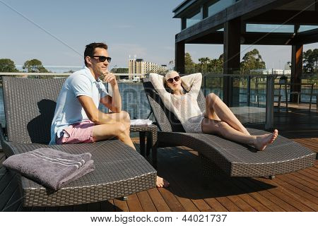 Couple On Sunbed