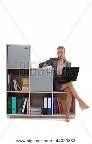 Woman sat on office furniture