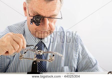 Older Man Repairing Watchmaker