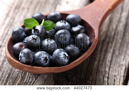 Blueberry in a wooden spoon