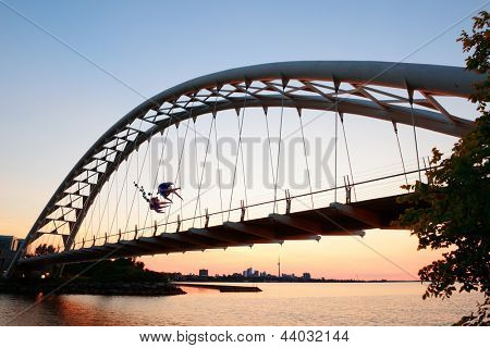 TORONTO, CANADA - JULY 3: Bridge with Toronto skyline at sunrise on July 3, 2012 in Toronto, Canada. Toronto with the population of 6M is the capital of Ontario and the largest city in Canada.