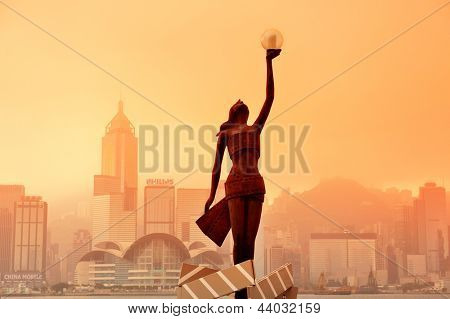 HONG KONG, CHINA - APR 17: Statue and skyline in Avenue of Stars on April 17, 2012 in Hong Kong, China. The promenade honours celebrities of the Hong Kong film industry as the famous city attraction.