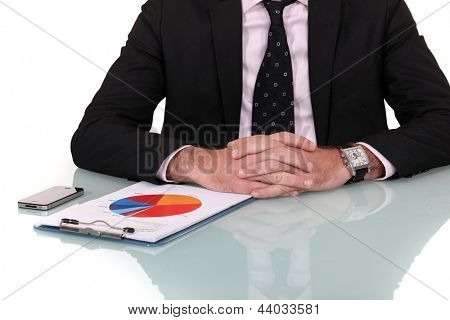 Businessman looking at marketing survey