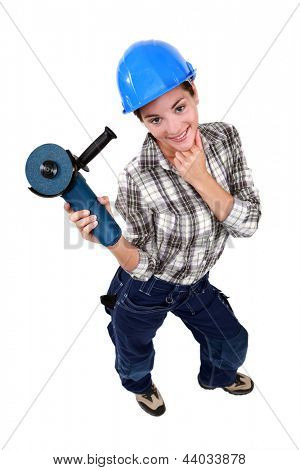 sexy craftswoman holding an electric saw