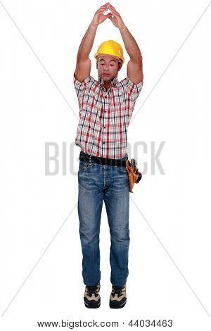 Tradesman raising his arms over his head
