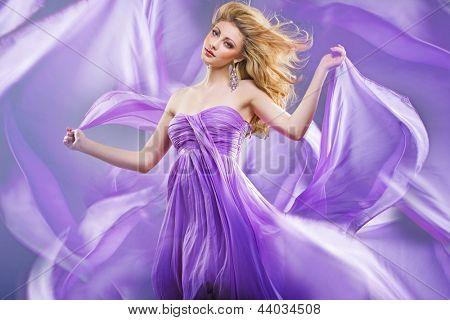 Fine art photo of a woman wearing beautiful dress