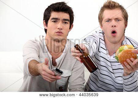 Young men watching TV