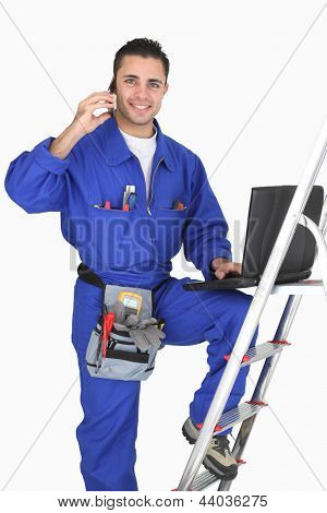 Electrician posing with his building materials and tools