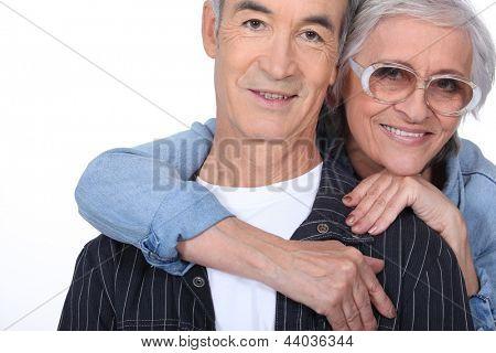 Elderly woman hugging her husband