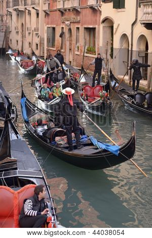 VENICE, ITALY - DECEMBER 31: Crowded traffic of gondolas in Venice, Italy on December 31, 2012. Gondolas is very popular transport among tourists in Venice