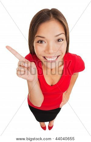 Grinning Woman Pointing To Left Of Frame