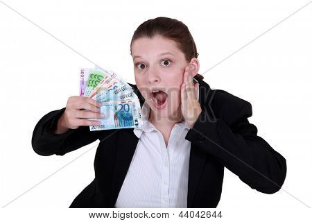 Shocked woman holding cash