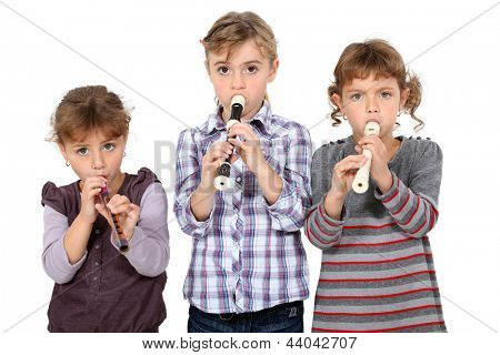 three little girls playing flute