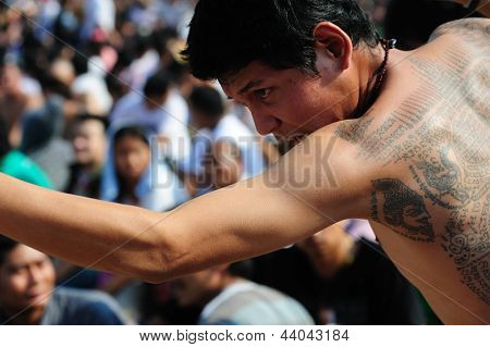 NAKHON CHAISI, THAILAND - MARCH 23: Participants at the wai khru ceremony fall into a deep trance on March 23, 2013 in wat bang phra, thailand.
