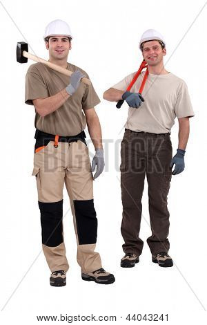 Tradesmen holding their tools