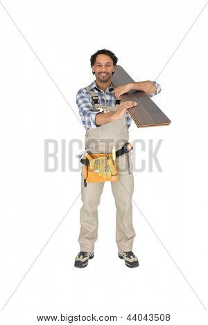Labourer carrying plywood