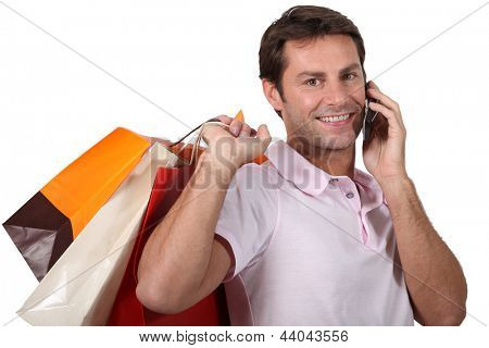 Man shopping and talking on his mobile phone