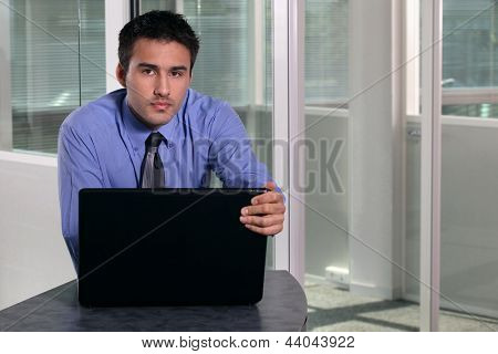 Serious businessman with a laptop