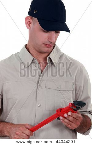 Handyman holding a vernier caliper